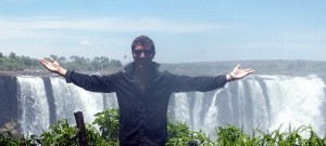 Keith standing in front of Victoria Falls, Zimbabwe/Zambia